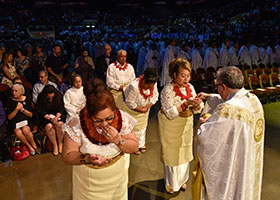Bishop Michael Olson gives Holy Communion to the Tongan community who brought up the gifts at the Fort Worth Diocese 50th Anniversary Mass, Wednesday Aug. 21, 2019 at the Convention Center in downtown Fort Worth.