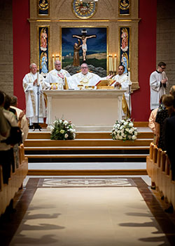 Bishop Michael Olson is joined by Father James Flynn (left) and Father Sojan George (right) as he celebrates Mass in the renovated sanctuary at St. Francis of Assisi Parish in Grapevine. (NTC/Kevin Bartram)