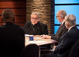 Bishop Olson speaks with panelists