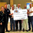 Knights of Columbus members hold up oversized check for $25,000