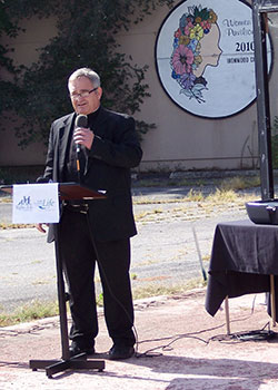 Father Glenn Kohrman, pastor of Holy Family and St. John the Baptist parishes in South Bend, Ind., and a board member of Catholic Charities of the Diocese of Fort Wayne-South Bend, speaks at a news conference Sept. 17, 2019, in South Bend.