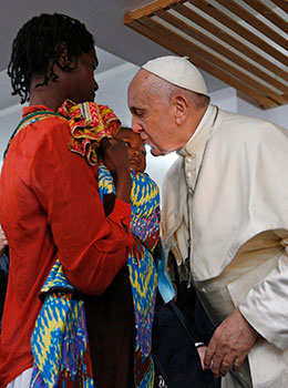 Pope Francis kisses a baby as he visits the Zimpeto Hospital outside Maputo, Mozambique, Sept. 6, 2019.