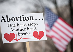 "A pro-life sign is displayed during the 2019 annual March for Life rally in Washington Jan. 18. By passing a bill to ban abortion in nearly all circumstances, the Alabama Legislature has recognized that abortion is ""the extinguishing of a unique human life,"" said the president and CEO of Americans United for Life. (CNS photo/Tyler Orsburn)"