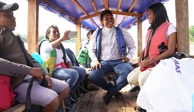 Deacon Ferney Pereira and members of his Colombian parish take a boat on a river in the Amazon Sept. 8, 2019.
