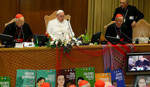 Pope Francis attends the final session of the Synod of Bishops for the Amazon at the Vatican Oct. 26, 2019. Also pictured are Cardinal Lorenzo Baldisseri, secretary-general of the Synod of Bishops, and Cardinal Claudio Hummes, relator general of the synod. (CNS photo/Paul Haring)