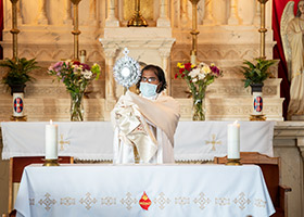 Father Vijaya Mareedu elevates the monstrance at Eastland's St. Francis Xavier Parish