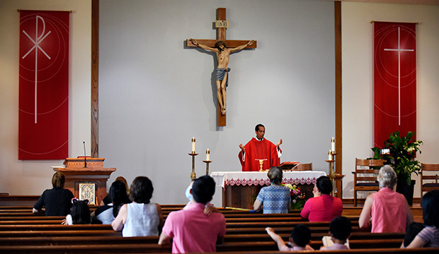 Father Joy Joseph celebrates Mass