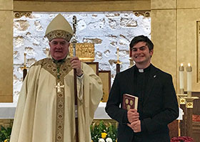 Bishop Michael Mulvey with Austin Evans
