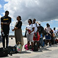 Residents wait to be evacuated at the airport in Marsh Harbour, Bahamas, Sept. 7, 2019, in the aftermath of Hurricane Dorian.
