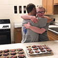 Two Bernadette Scholars hug after completing their entry in a home economics cupcake competition in December 2019.