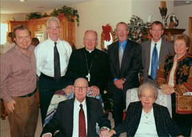 Bishop Vann poses with his four brothers and sister behind his seated parents