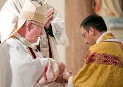 Bishop Vann anoints Fr. Holguin's hands with the holy oil of chrism, as a sign of their sanctification to God's service.