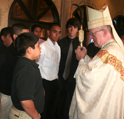 Bishop Kevin Vann greets a group of Columbian Squires  from San Antonio after the Mass.