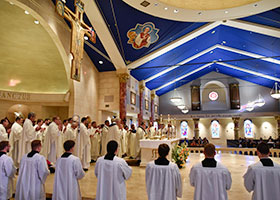 Priests and seminarians gather during the Eucharistic Prayer.