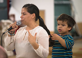 Ingrid, seen with her son, shares her immigration story about coming north from Nicaragua at Corpus Christi Church in Ciudad Juarez, Mexico, Sept. 24, 2019. Her talk was part of a pastoral encounter by U.S. bishops with migrants at the border. The Sept. 23-27 pastoral visit, sponsored by various offices of the U.S. Conference of Catholic Bishops and other national organizations, aimed to highlight the church's ministry to migrants, the border conditions and immigration laws affecting them, and their material and spiritual needs.