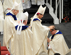 Archbishop Gacria-Siller lays hands on Bishop Olson, ordaining him to the episcopate. Behind him are Archbishop Fiorenza (left), and Bishop Vann (right).