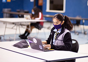 students work virtually from the Cristo Rey gym
