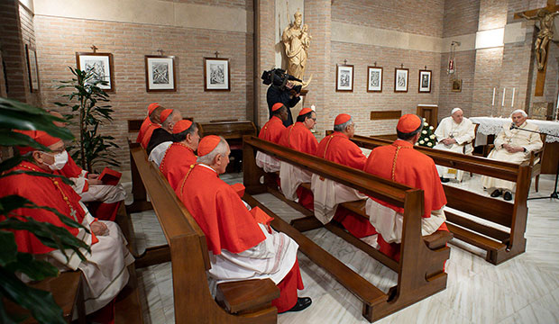Pope Francis and new cardinals visit with retired Pope Benedict XVI at the retired pope's residence after a consistory at the Vatican Nov. 28, 2020.