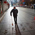 A man in Jiujiang, China, wears a face mask Feb. 3, 2020, as the country is hit by the coronavirus.
