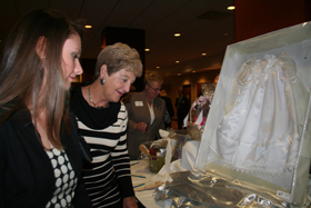 Participants view a christening gown for auction at the Bishop's annual Pro-Life Banquet. The annual banquet supports diocesan pro-life programs.