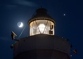 Jupiter is seen shining to the right of the Cape Murro di Porco Lighthouse in Syracuse, Sicily