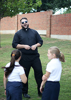 Seminarian Sam Maul visits with students at Holy Trinity Catholic School in Grapevine.