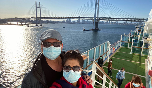Marichu and Ding Camales-Torrijos, of St. Matthew Parish in Vancouver, British Columbia, pose wearing protective masks during a brief walk outdoors on the Diamond Princess cruise ship.