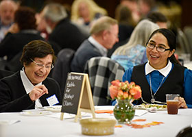 Sr. Eva Sanchez, left, and Sr. Aracely Lobaton have dinner after a special prayer with Bishop Michael Olson during the Liturgy of the Hours evening prayer at the Cathedral Pastoral Center in Fort Worth, Nov. 08, 2019. NTC PHOTO/BEN TORRES