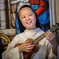 Sister Mary Catherine Do, OP, plays ukelele
