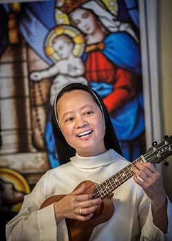 Sister Mary Catherine Do, OP, plays the ukelele
