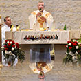 Msgr. Publius Xuereb raises the Blood of Christ during his 50th anniversary Mass as a priest at Holy Redeemer Parish in Aledo, May 6, 2018.