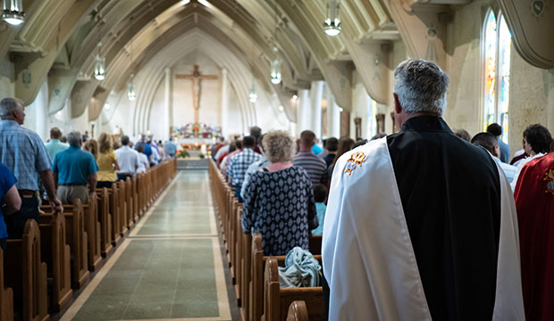 Fourth Degree Knights of Columbus stand during a Mass celebrated by Father Ken Robinson at Sacred Heart Parish in Muenster, May 26, 2019.