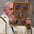 Pope holding book of the Gospels