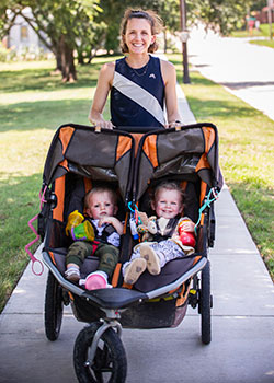 Elizabeth Northern pushing double stroller with her two kids