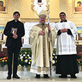 Austin Evans, Bishop Michael Mulvey, and Eric Flores