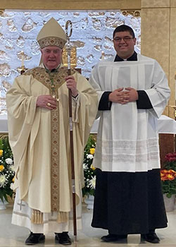 Bishop Michael Mulvey and Eric Flores