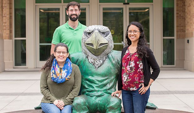 From left, FOCUS missionaries Jeannette Hanon, Conrad Collins, and Anna Fernandez on the University of North Texas campus with Scrappy. (NTC/Jayme Donahue)