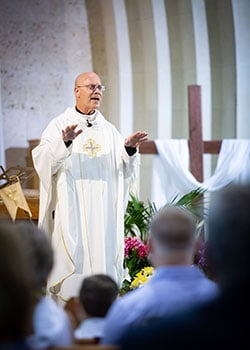 Father Ken Robinson celebrates mass at Sacred Heart Catholic Church in Muenster, Texas on Sunday, May 26, 2019. (Photo by Kevin Bartram)