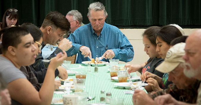 Pete Loftin eats dinner with locals in Cisco.
