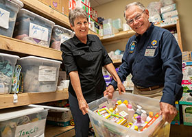 Angela Walters, diocesan coordinator of Gabriel Project, and her husband, Bob Walters, show some of the items mothers in crisis pregnancies receive when they reach out to Gabriel Project.
