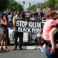 Protesters in Minneapolis gather at the scene May 27, 2020, where George Floyd, an unarmed black man, was pinned down by a police officer kneeling on his neck before later dying in hospital May 25.