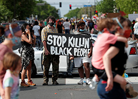 Protesters in Minneapolis gather at the scene May 27, 2020, where George Floyd, an unarmed black man, was pinned down by a police officer kneeling on his neck before later dying in hospital May 25. (CNS photo/Eric Miller, Reuters)