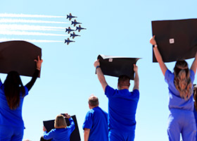 Blue Angels with health care workers