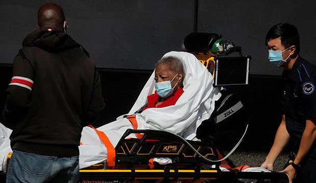 A patient in the Brooklyn borough of New York City arrives at the Emergency entrance