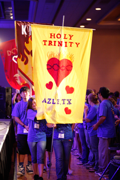 DCYC youth from Holy Trinity process in carrying the banner representing their parish