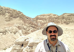 Seminarian Joseph Moreno at the Qumran Caves, where the Dead Sea Scrolls were discovered