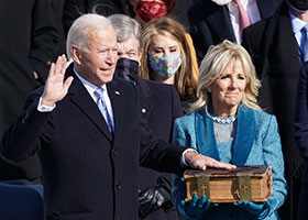 Biden with hand on Bible