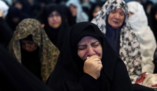A woman weeps during Friday prayers in Tehran, Iran, Jan. 3, 2020, after Iranian Maj. Gen. Qassem Soleimani was killed in a U.S. drone airstrike at Baghdad International Airport earlier that day. (CNS photo/Nazanin Tabatabaee, West Asia News Agency via Reuters)