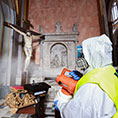 A worker sprays disinfectant to combat the coronavirus in the Basilica of San Domenico Maggiore in Naples, Italy, March 6, 2020.