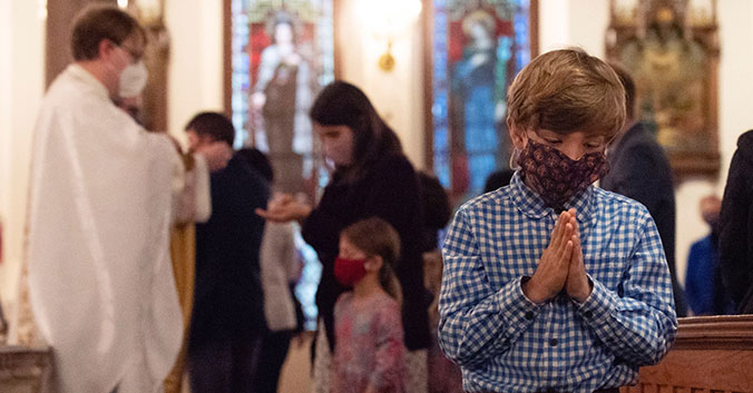 Boy receives Communion at Respect Life Mass